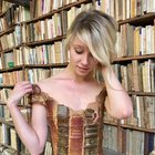 CuBkf8VFYhwTELHu0EuahWK9FV90QW4MTqsl8299r c Girl wearing the dress made from book spines. Made by French designer Sylvie Facon.