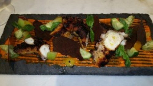 Grilled Octopus, piquillo puree, pickled baby tomatillos, black olive tuile