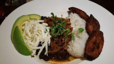 Palellon Criollo (seasoned pulled beef, white rice, black beans, fried sweet plantains)