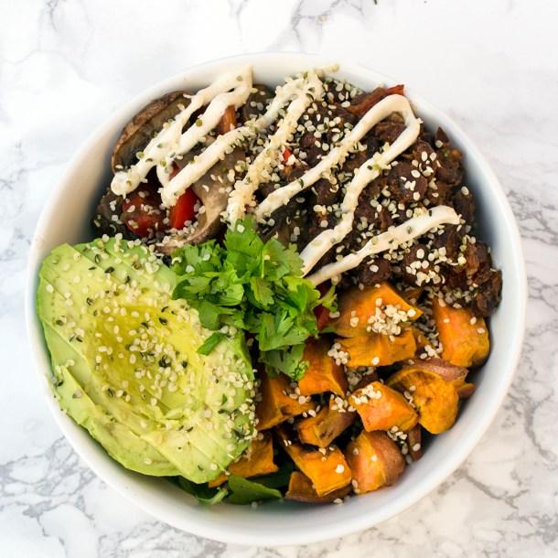 vegan sweet potato black bean burrito bowl with cashew sour cream