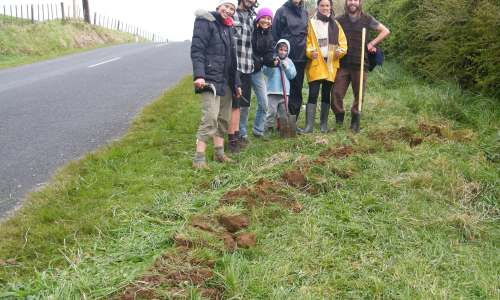 Permaculture students with their first spoon drain, ready to soak run-off from the road into the ground. copy