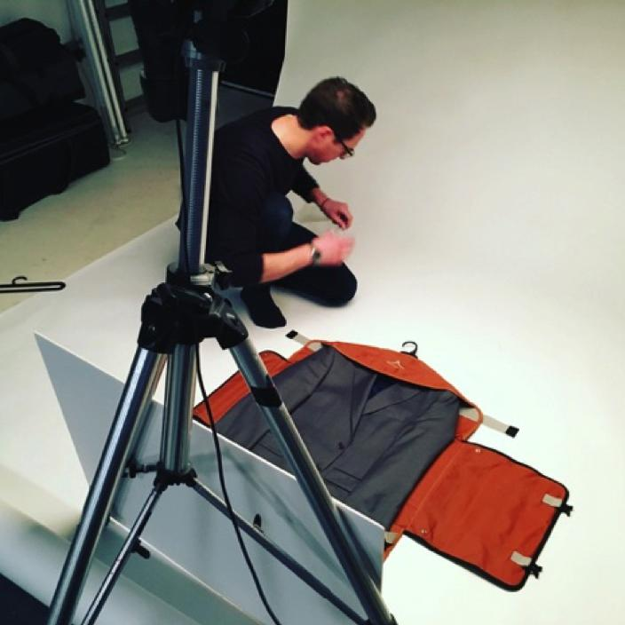 Charlie at work in the studio preparing the PLIQO bag for shooting.