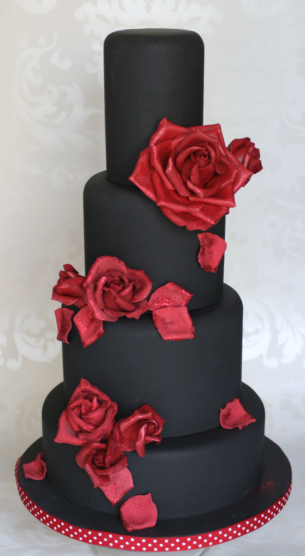 Black wedding cake with red roses