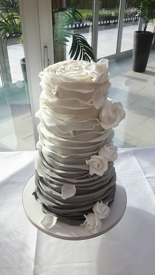 White and grey ombre ruffle wedding cake