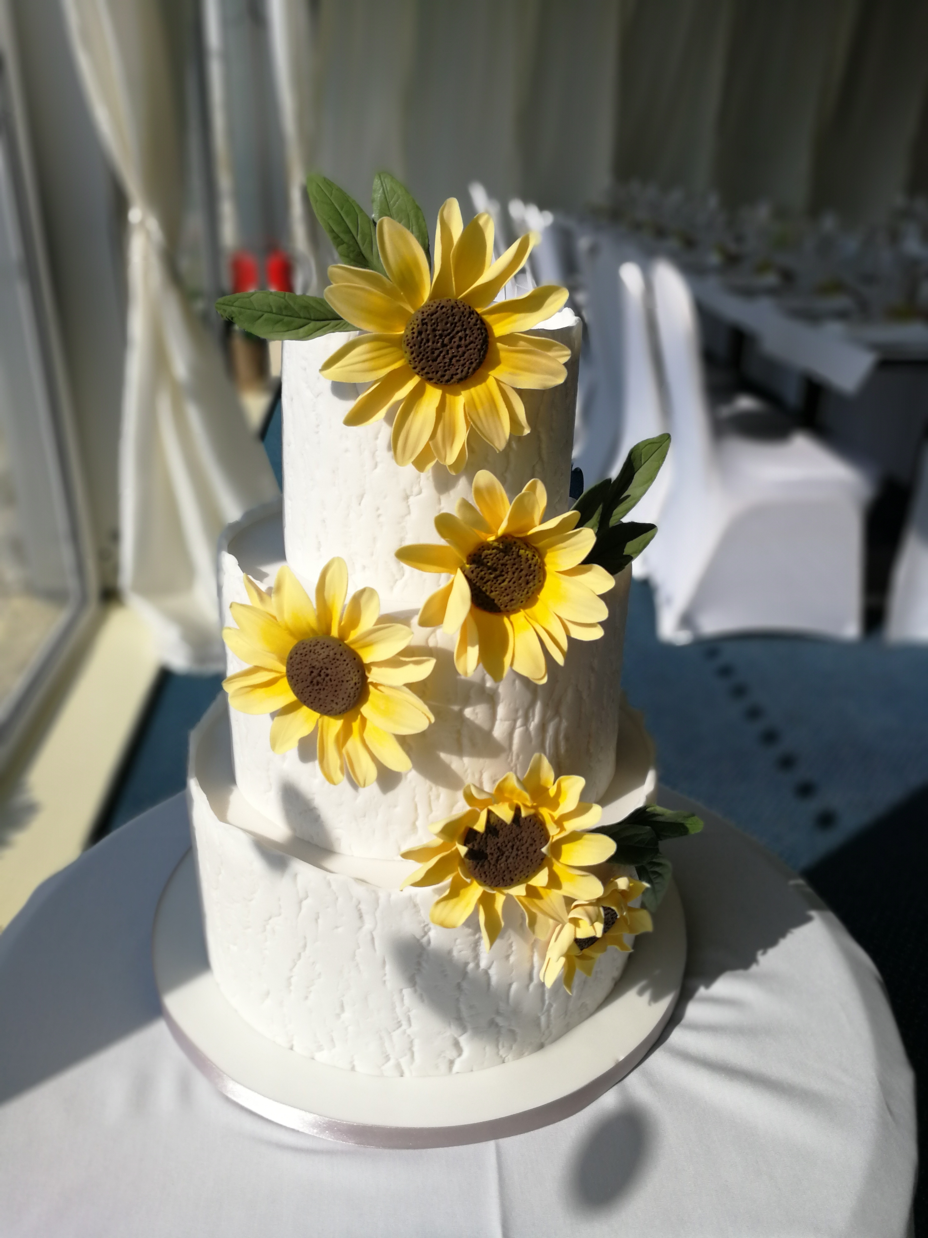 Sunflower wedding cake with wood textured icing