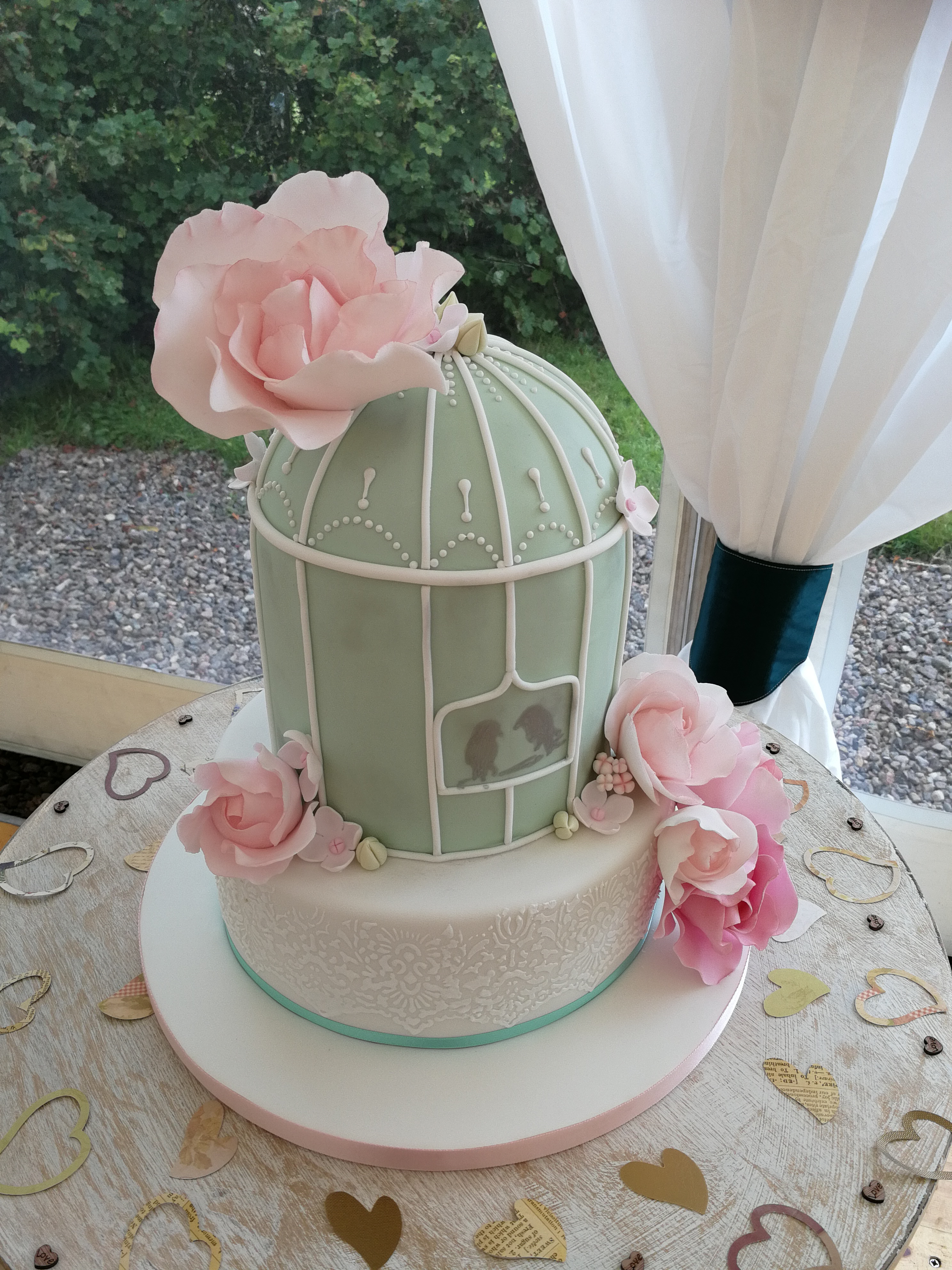 Birdcage wedding cake with lace detail and pink sugar flowers