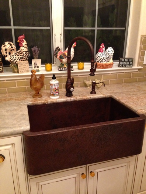 french country kitchen with copper farm