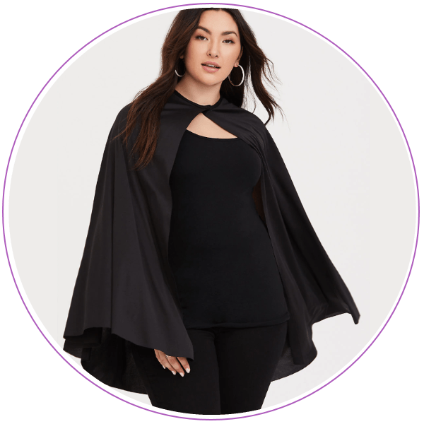 Woman wearing all black and a black cape