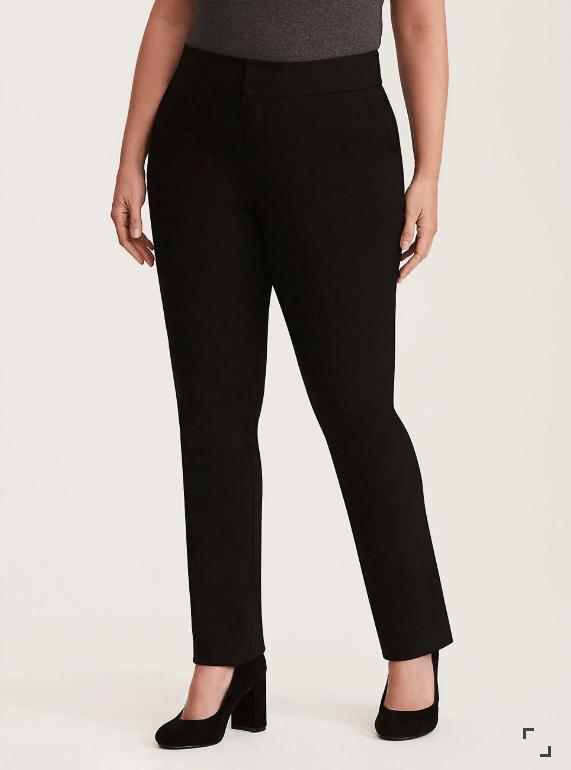 Woman wearing black pants