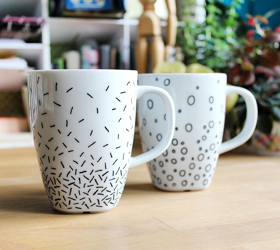 Last Week I decorated coffee mugs with a porcelain marker