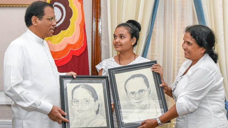 President provides financial assistance to Samindya Devindi, a hearing-impaired child, for her future art-work activities