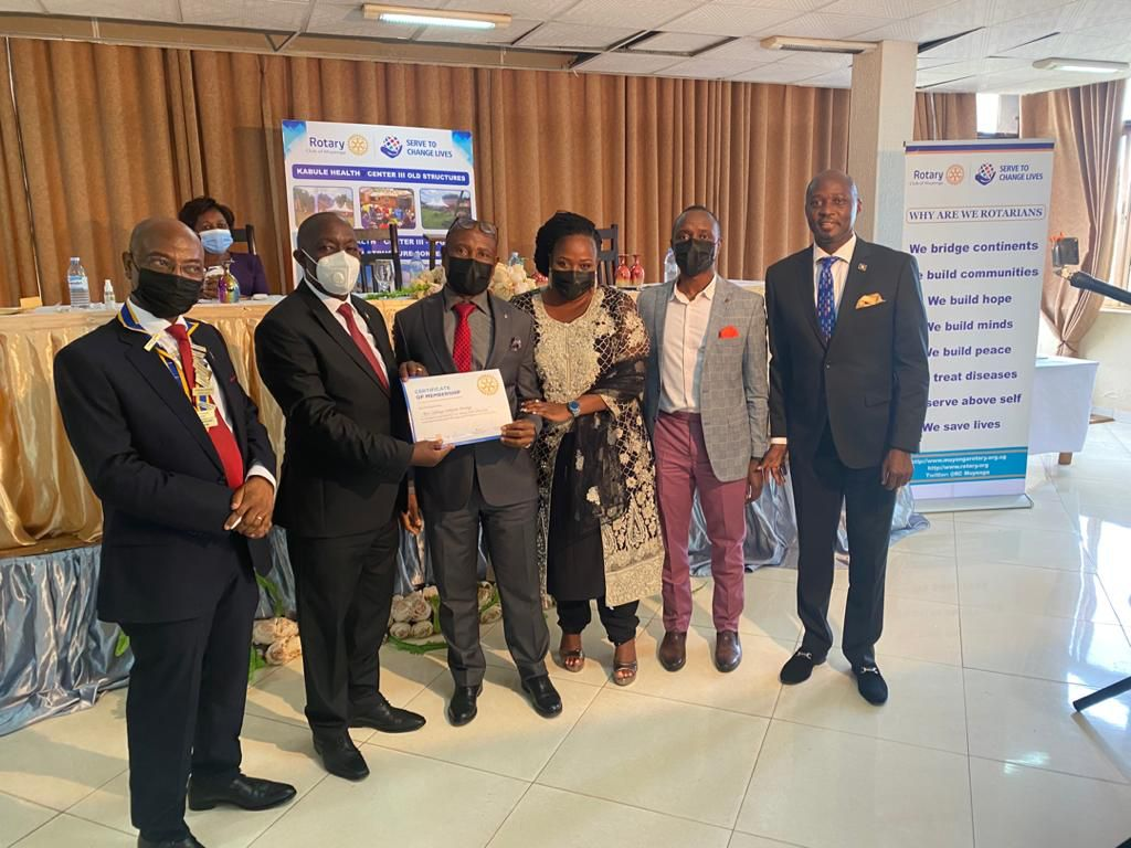 Mr. Simpson Birungi is awarded a Certificate of Membership for joining the Rotary Club of Muyenga.
