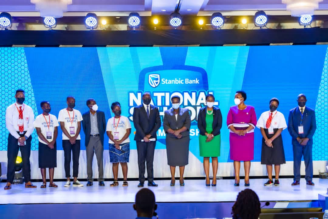 Guest of Honor, Vice President Jessica Alupo, Stanbic Bank CEO Anne Juuko pose for a picture with some of the participating students and teachers (PHOTO/Courtesy)