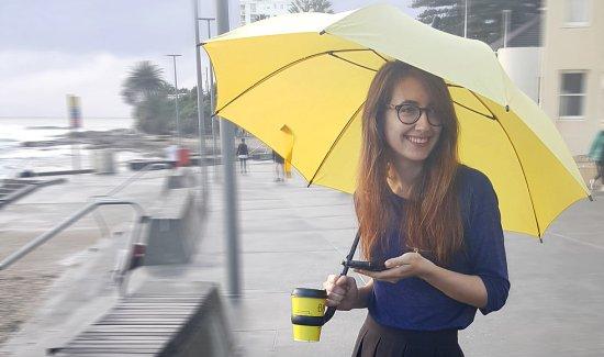 Coffee holding Umbrella