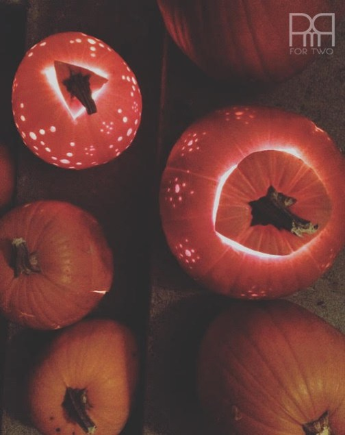 drilled pumpkins lit