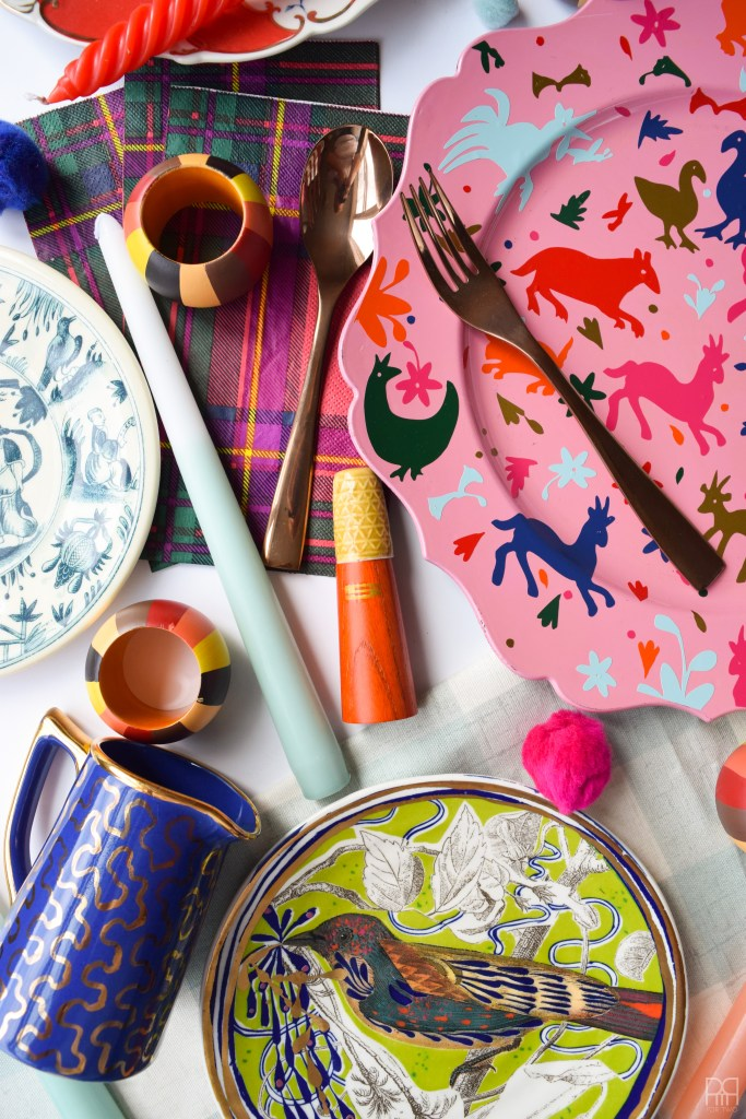 Vinyl Otomi Chargers make a tablescape pop. Make your own using vinyl, your Cricut, and a bit of elbow grease. These colourful chargers are the perfect accessory for any place setting or colourful table decor