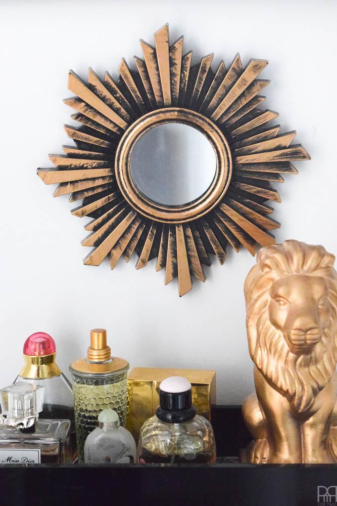 sunburst mirror and lion