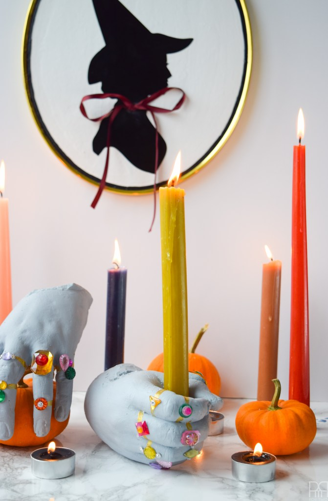 DIY Grave Robber Hands for a spooky piece of Halloween decor-Using plaster hand casts, paint, and little gemstones you can make some spooky things!