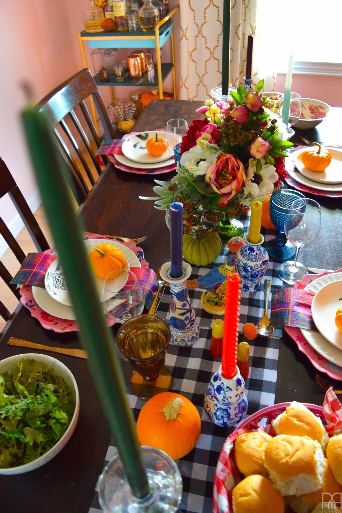 An eclectic and colourful thanksgiving tablescape that puts hearth and home and bold patterns on display in a season of giving.