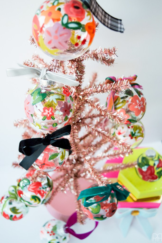 Who says Christmas has to be just red and green? Create beautiful floral christmas ornaments with some paint!
