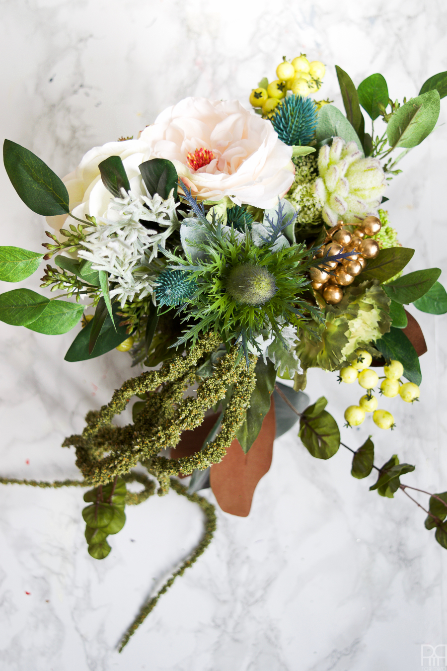 I made a winter wedding bouquet using greens, pinks, and subtle shades of blue. Perfect for any winter nuptials!