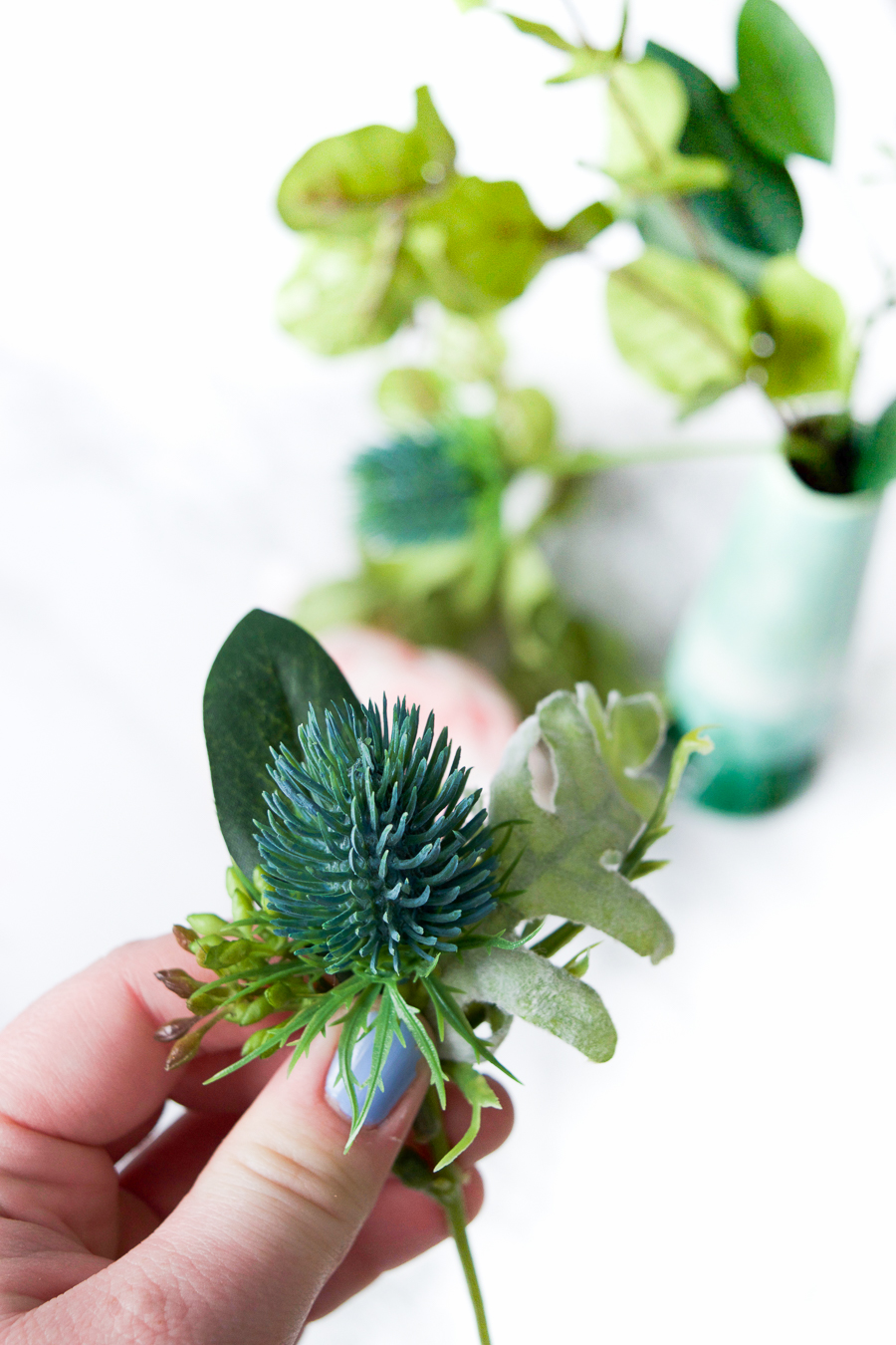 Make your own Winter Wedding Boutonnieres in under 4 minutes with these beautiful silk florals.