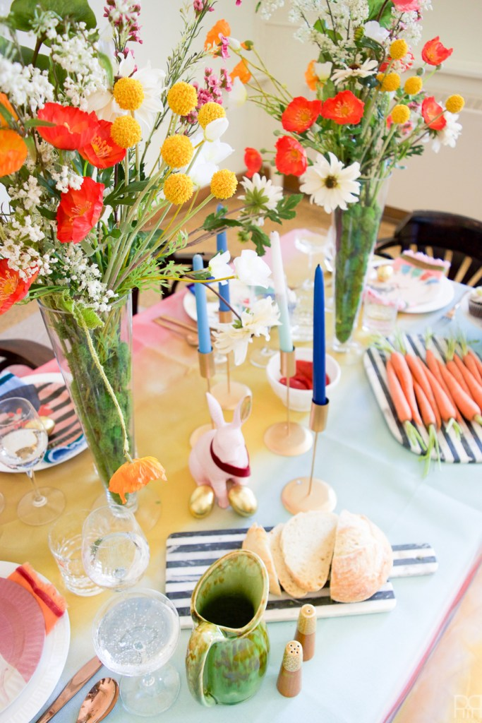 Using Krylon Spray Paint I created a colourful tablecloth at the centre of my eclectic & colourful easter table decor. Florals, bunnies and more abound in this colourful tablescape.