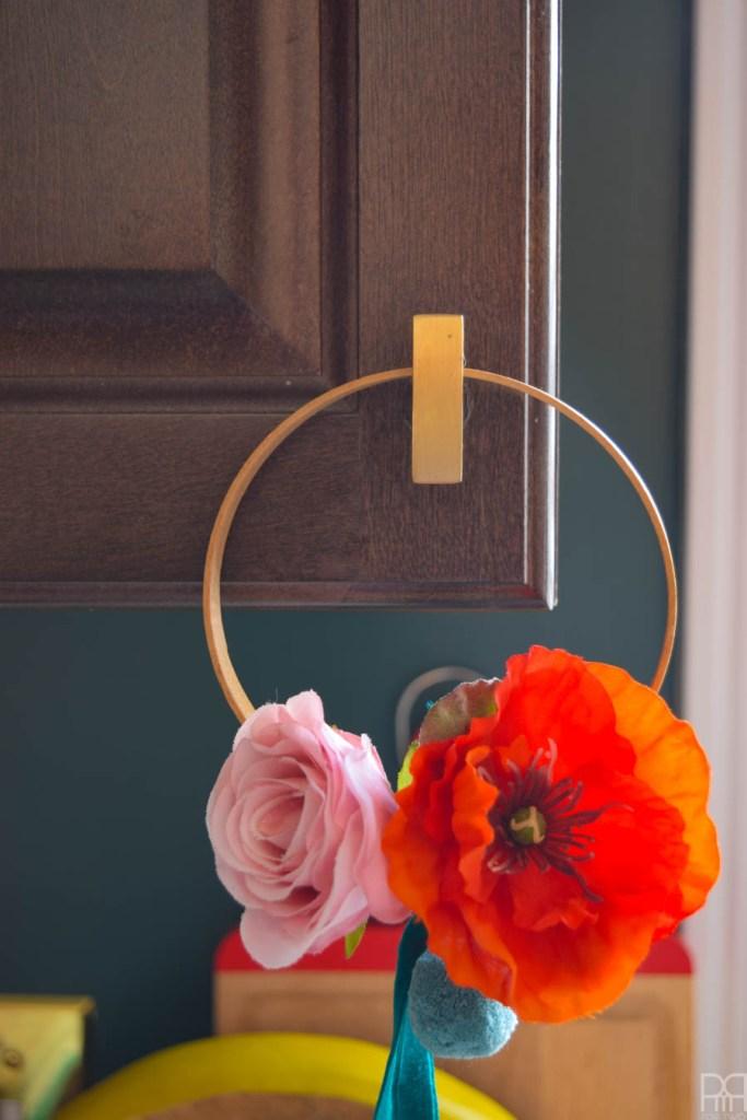 mini hoop wreath on a cupboard knob