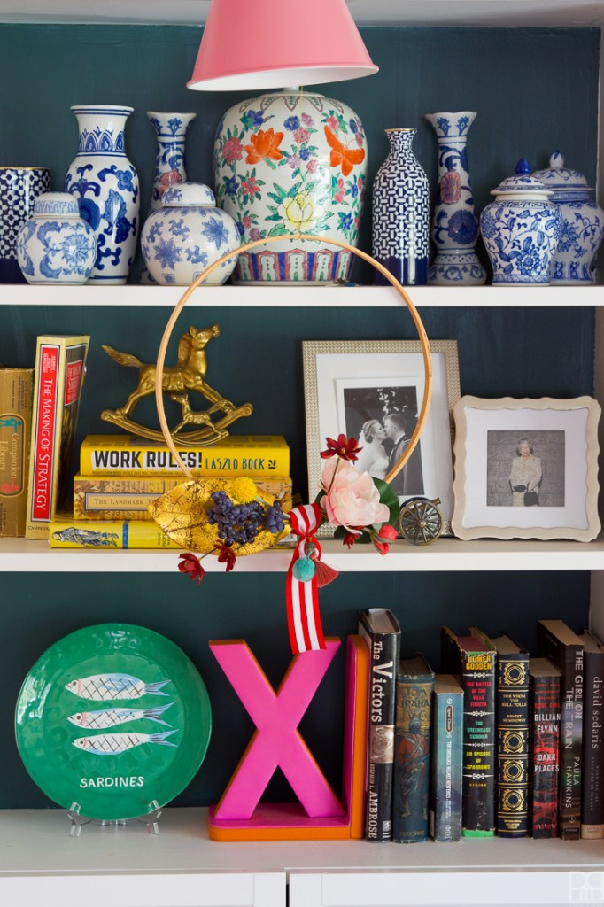 big hoop wreath in front of shelves