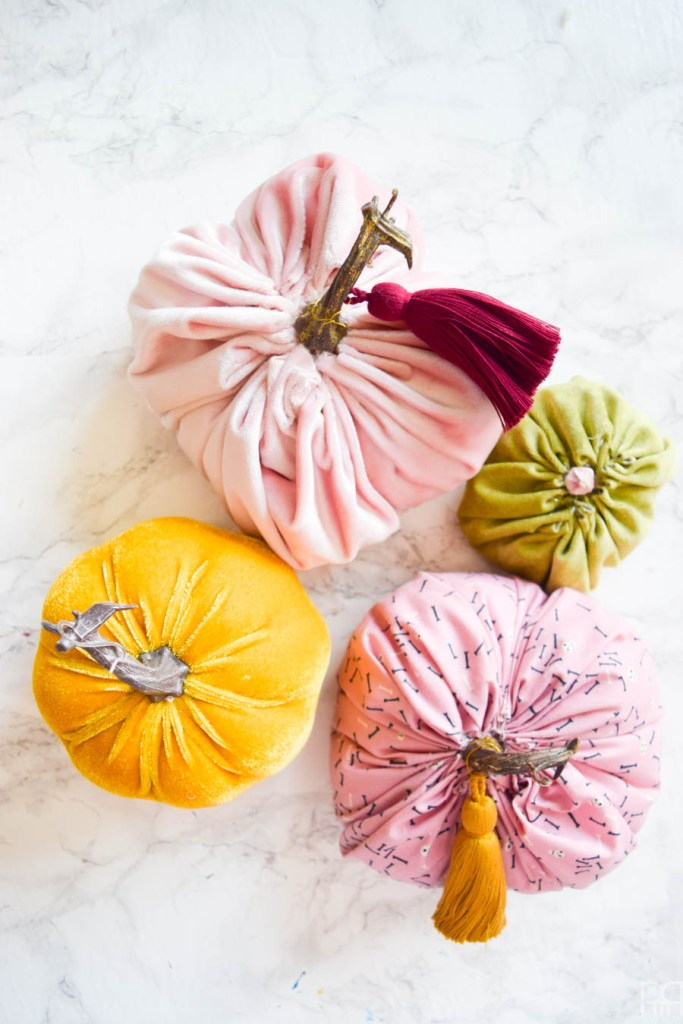 flat lay photo of 4 diy fabric pumpkin