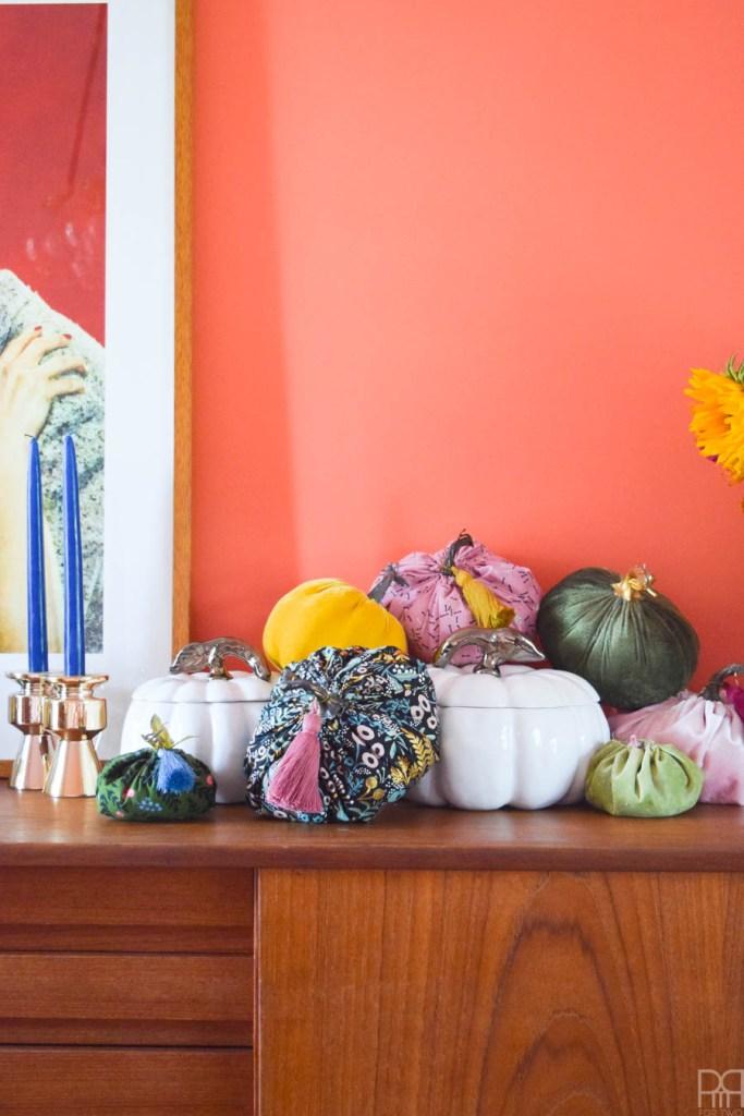 DIY colourful fabric pumpkins on a teak sideboard