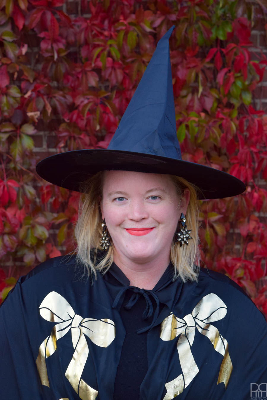 close up of woman in witch halloween costume