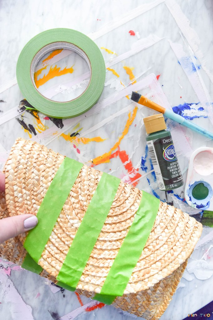 My gucci inspired straw clutch cost me a grand total of about 20$, took less than an hour to make, and is going to be an absolute hit this summer. So what are you waiting for? Get your hands on some raffia pom poms and paint.