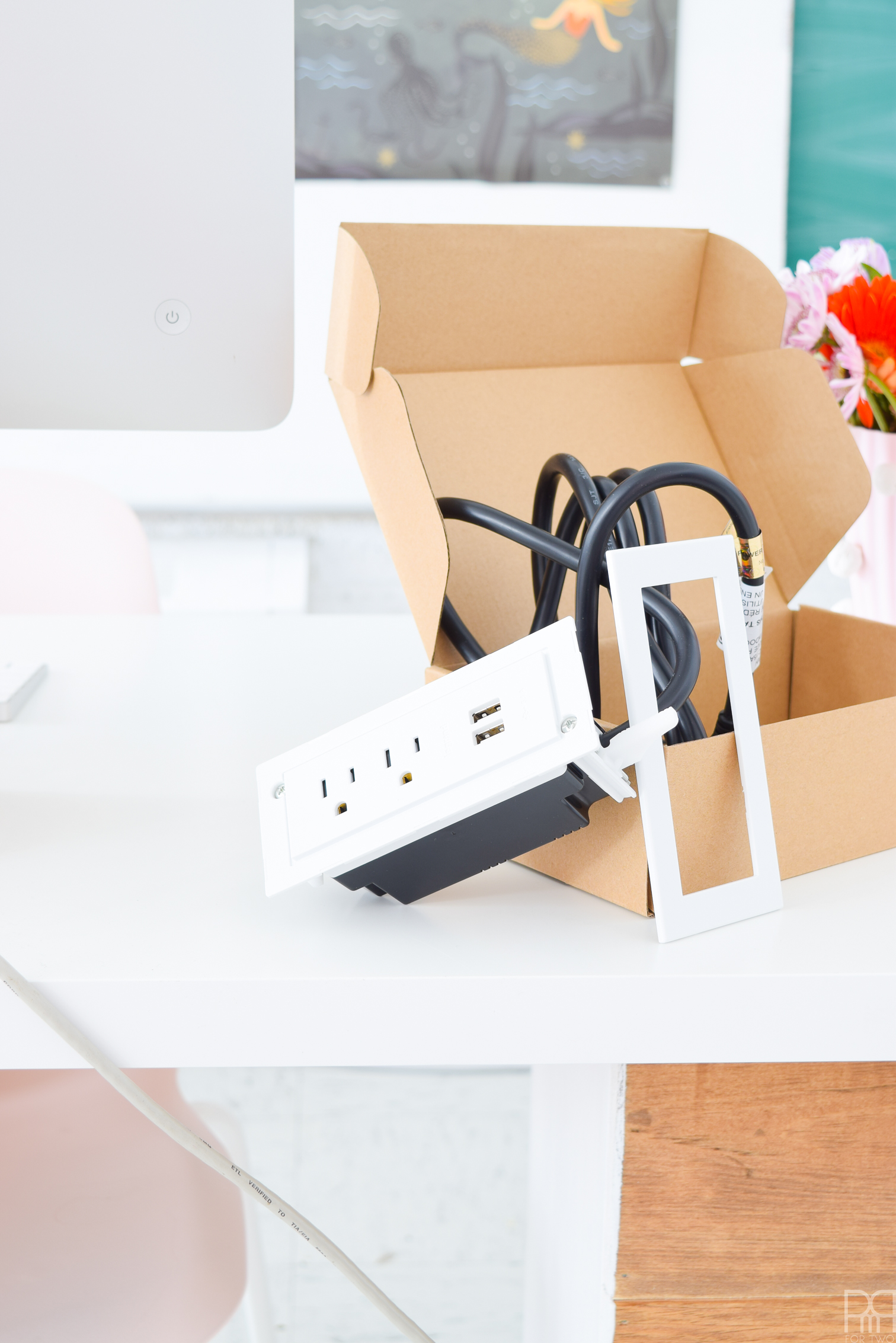 Looking for a solution to the power cord jumble at your desk? Try an in-furniture power unit! Legrand makes an easy to install and stylish model with USB plugs. You can't ask for much more in desktop solutions.
