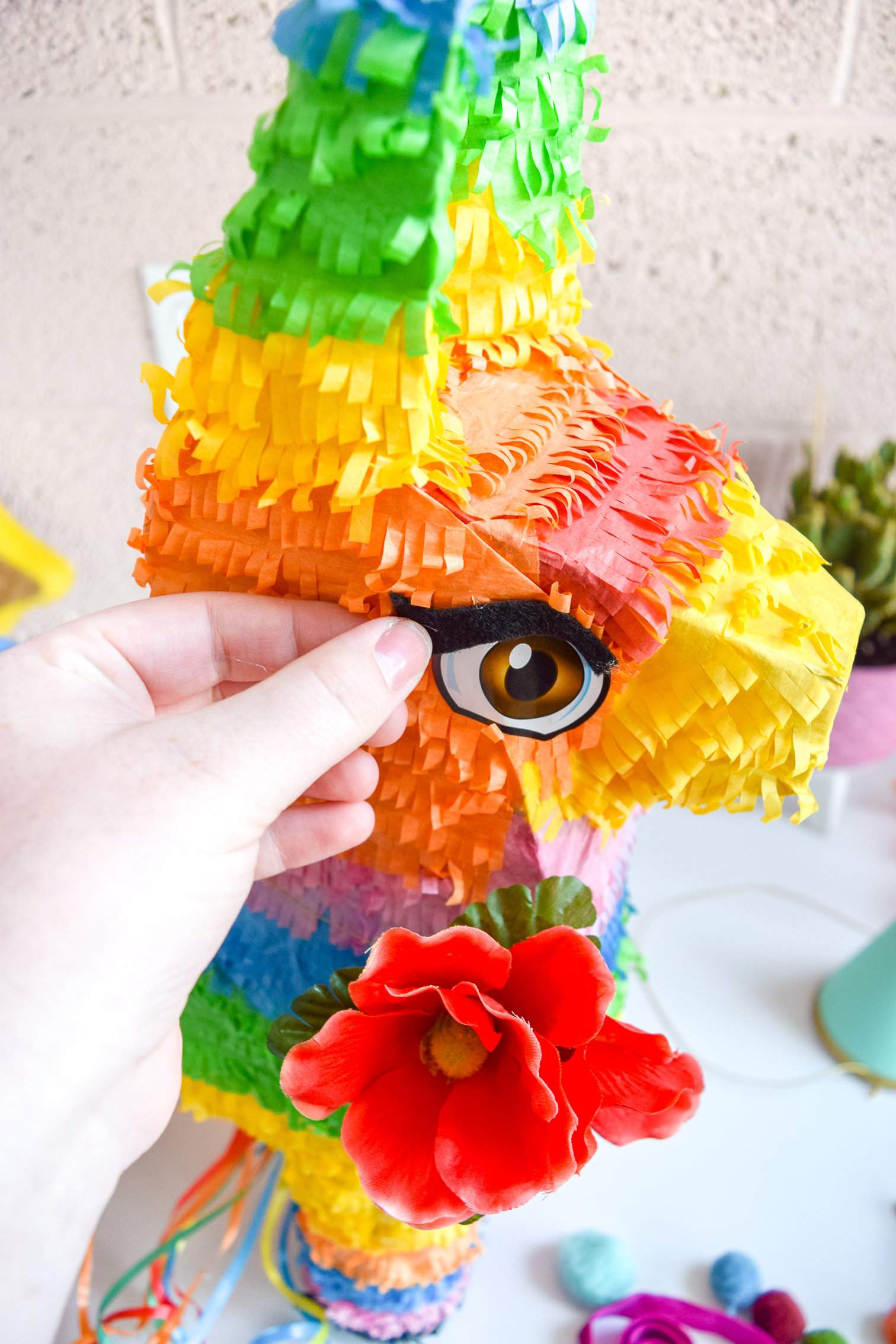 Miss Vanjie - my DIY Bougie piñata, was created to kick off my Cinco de Mayo celebration planning, and as a tribute to S10 of RPDR's first eliminated queen. Grab a basic piñata and dress her up with a cat eye, some ribbons, and lots of tinsel tassels.