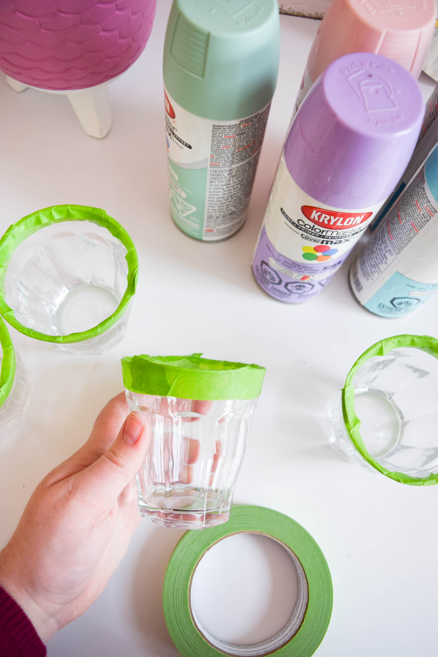 DIY Ombre Margarita Glasses (and margaritas!) to help you get your drank on. All you need is Krylon spray paint and some miss-matched glasses from the thrift store.