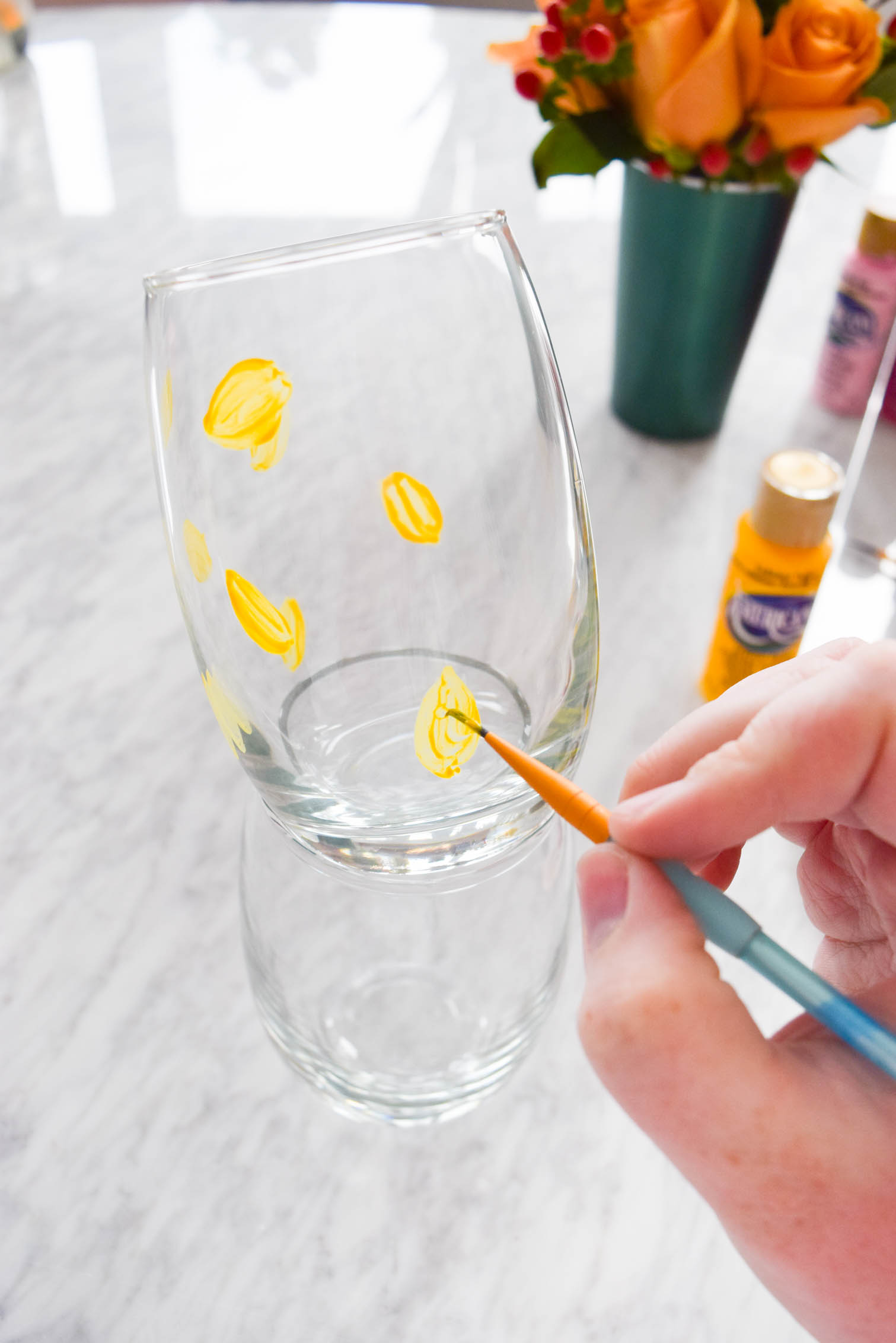 My DIY Painted Plaid & Lemon Glasses are the cutest thing you'll see all day. You can make your own summer drinkware with a retro and fun vibe, in just an afternoon.
