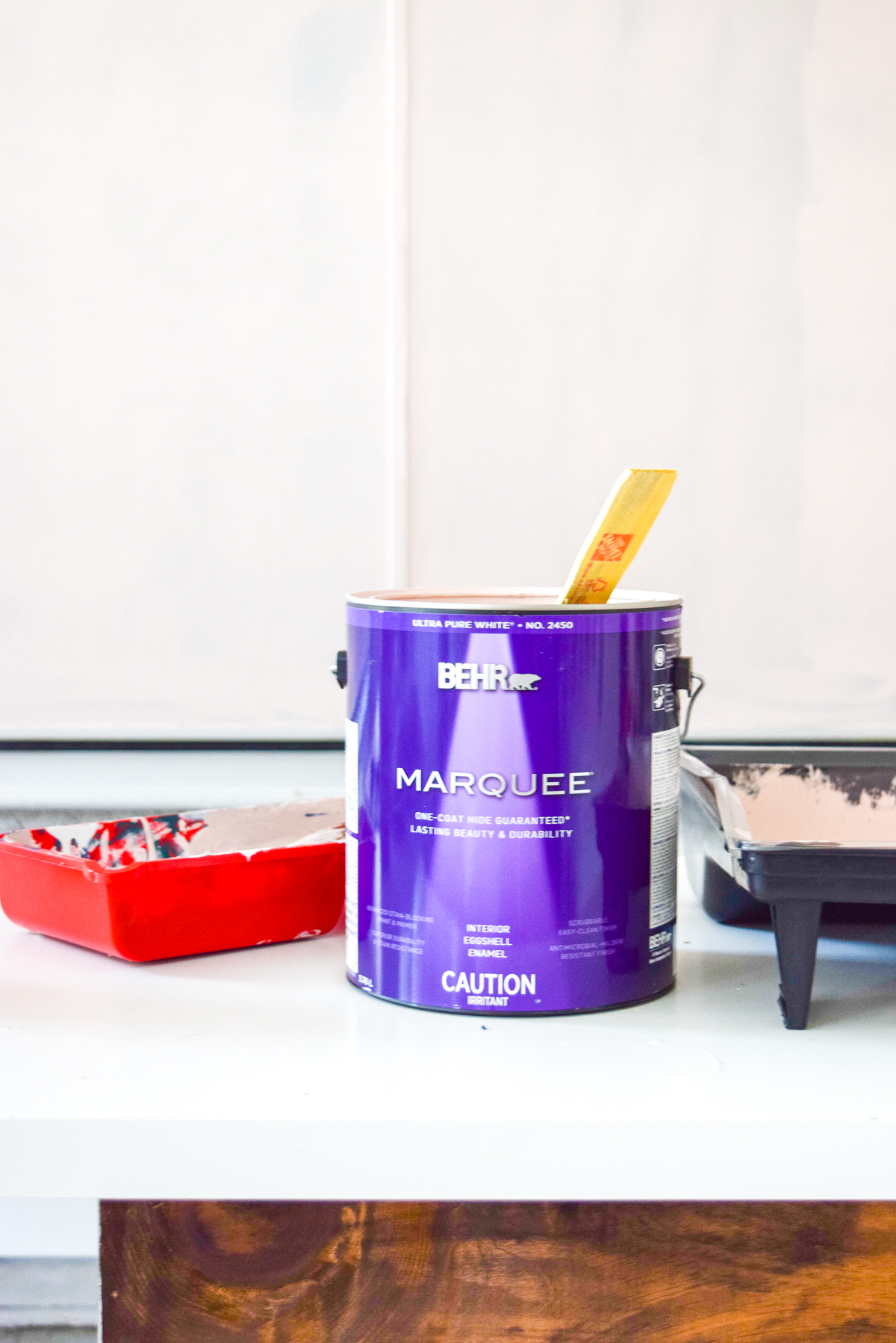 can of marquee BEHR paint on a desk