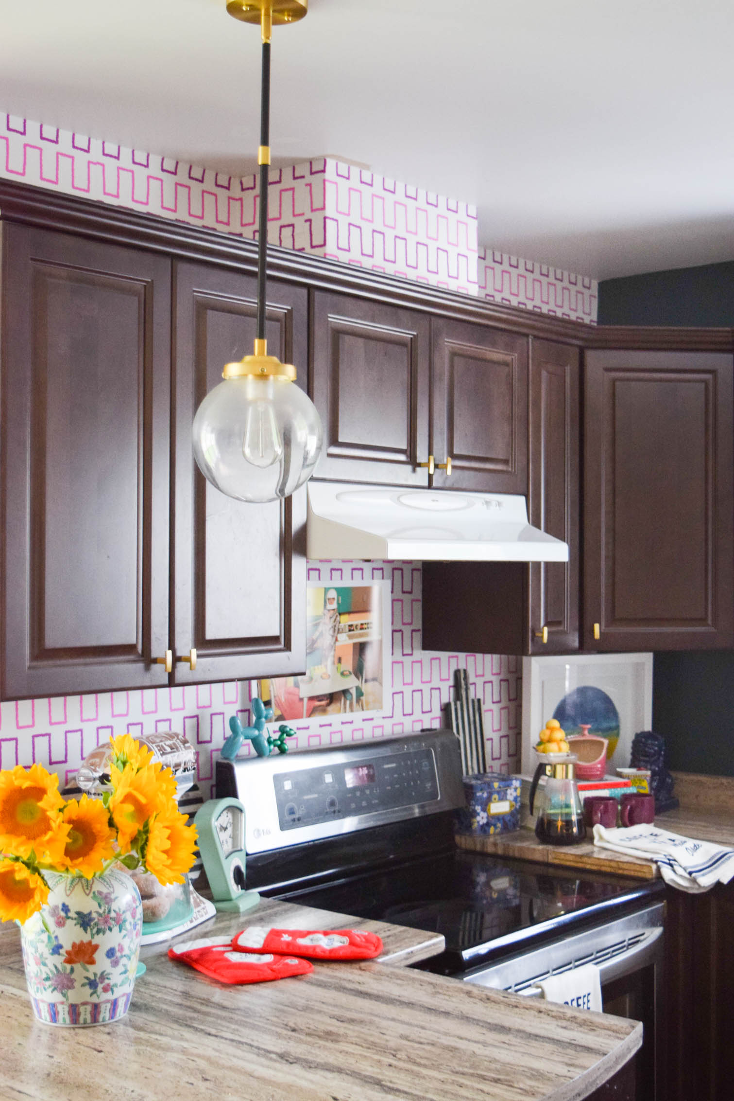 colourful and eclectic kitchen with dark cupboards