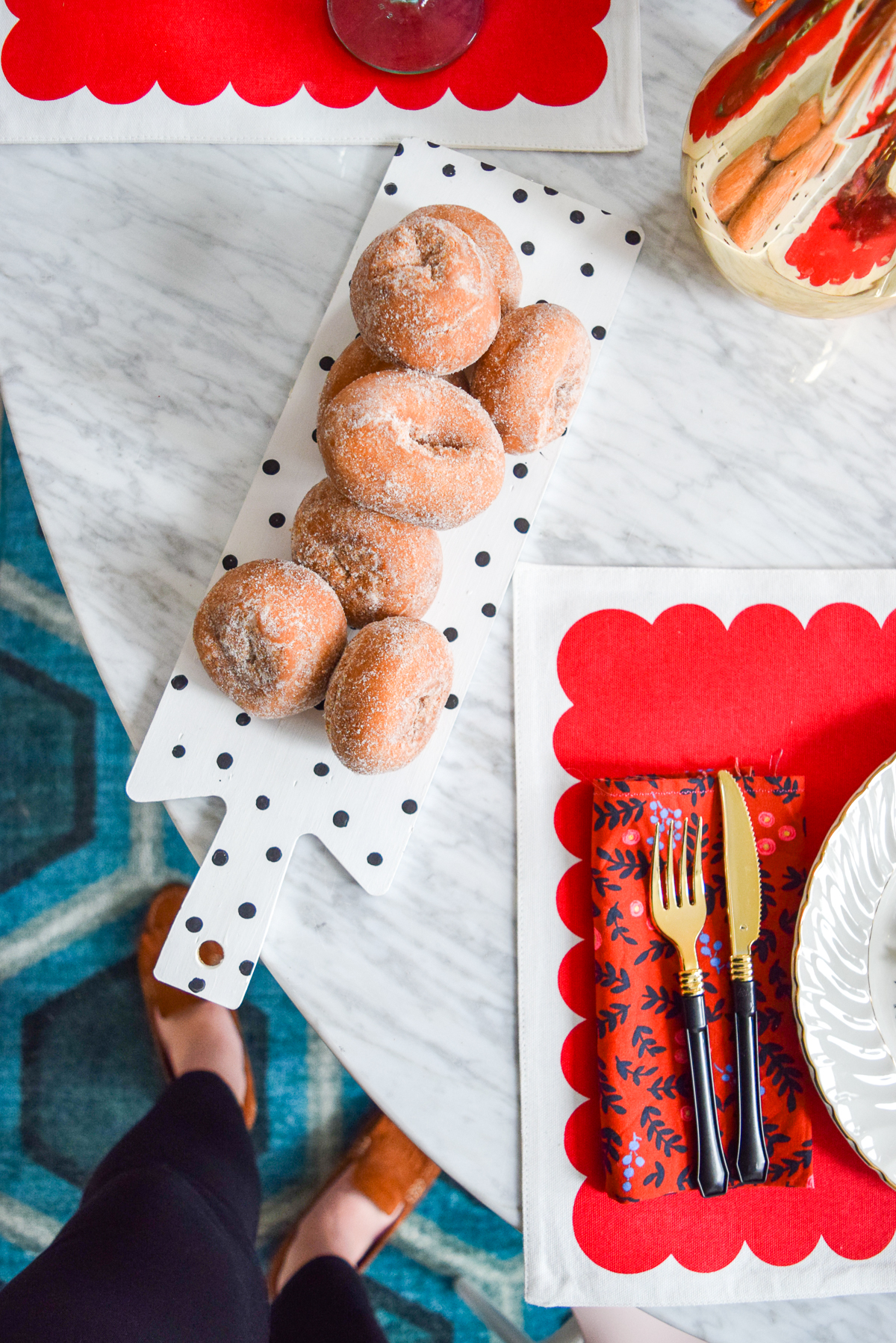 donuts on a black and white polka dot tray