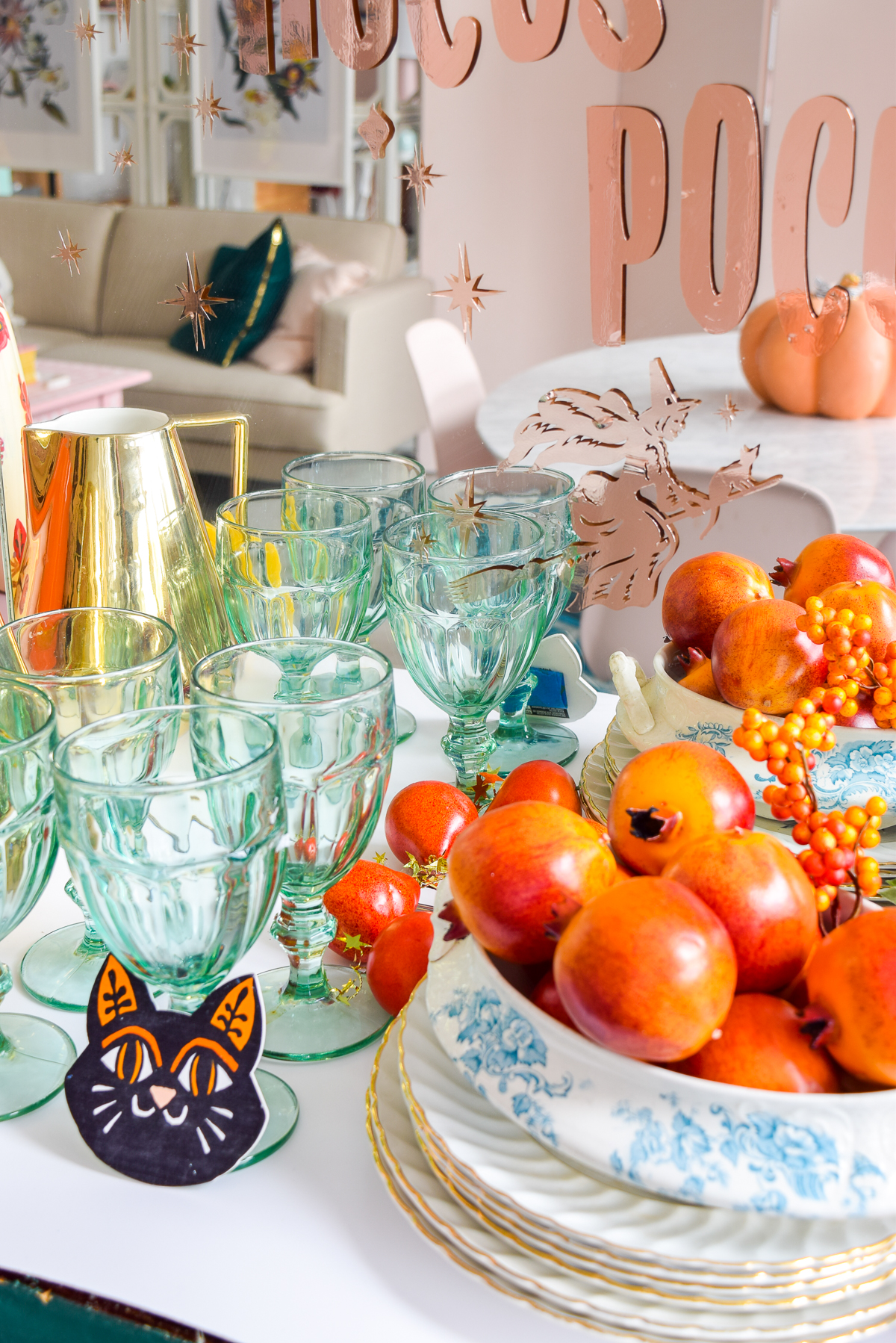 close-up shot of blue goblets and pomegranates on a counter