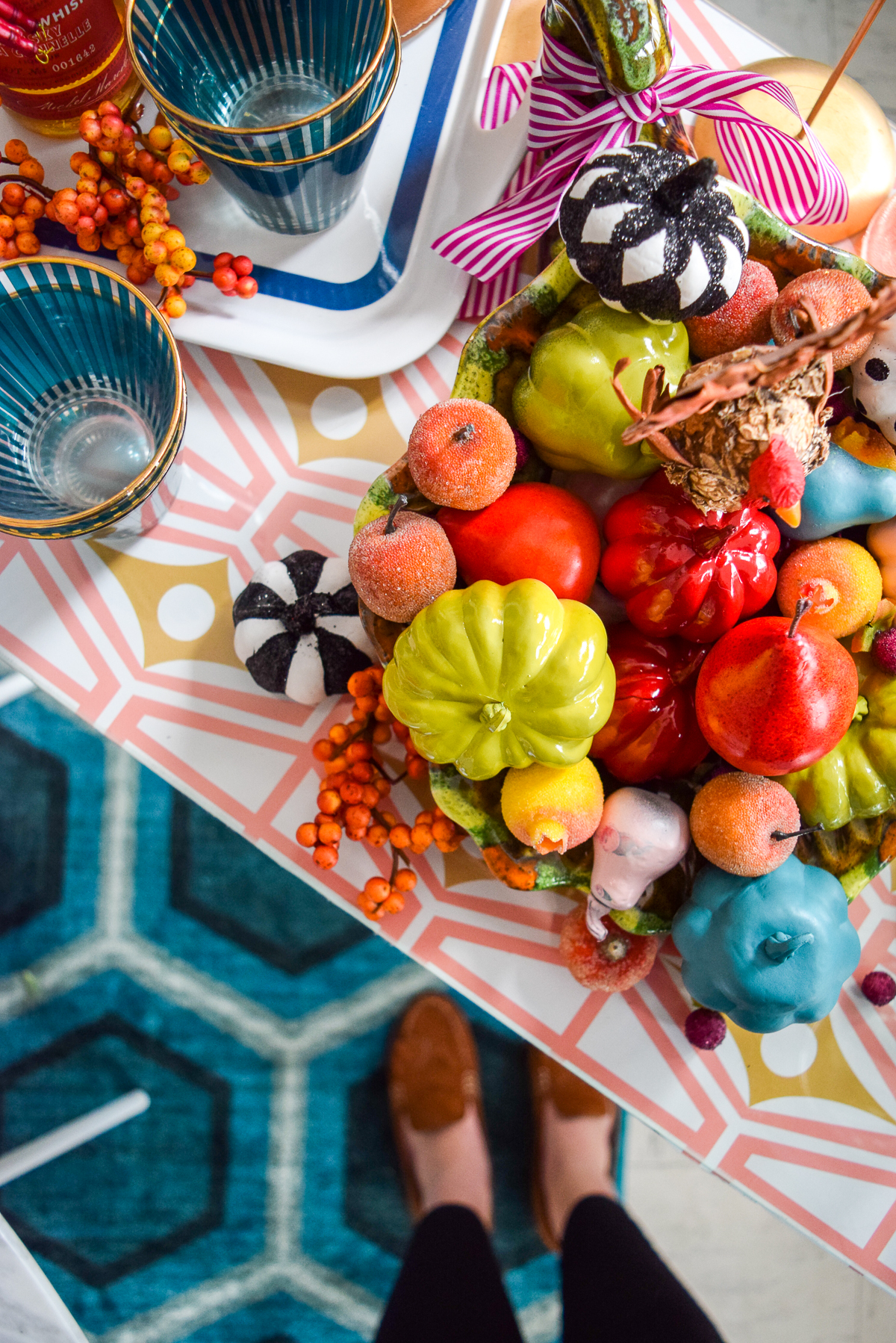 downwards view of a sidetable with a colourful cornucopia