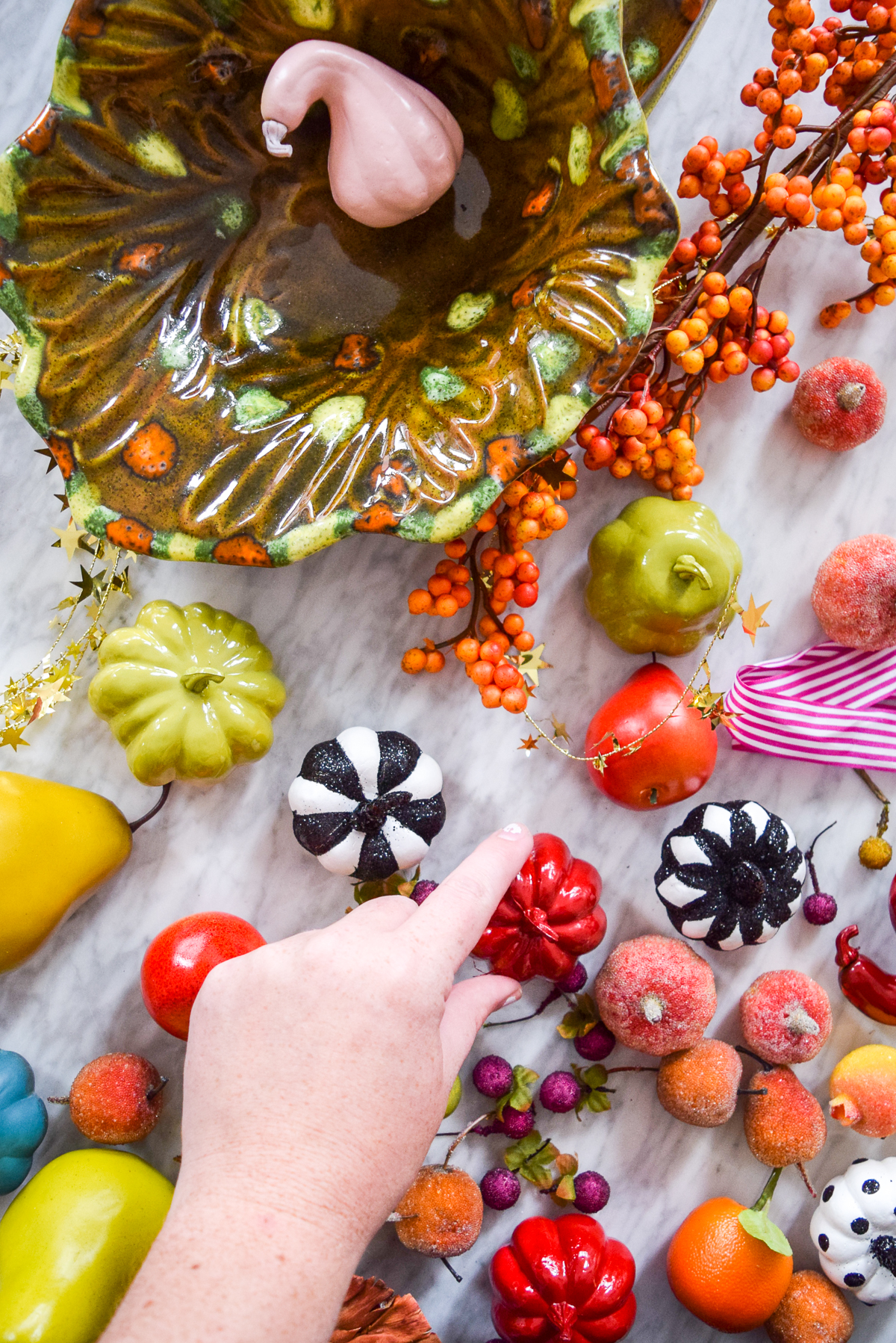 colourful pumpkins and fruit on a marble table
