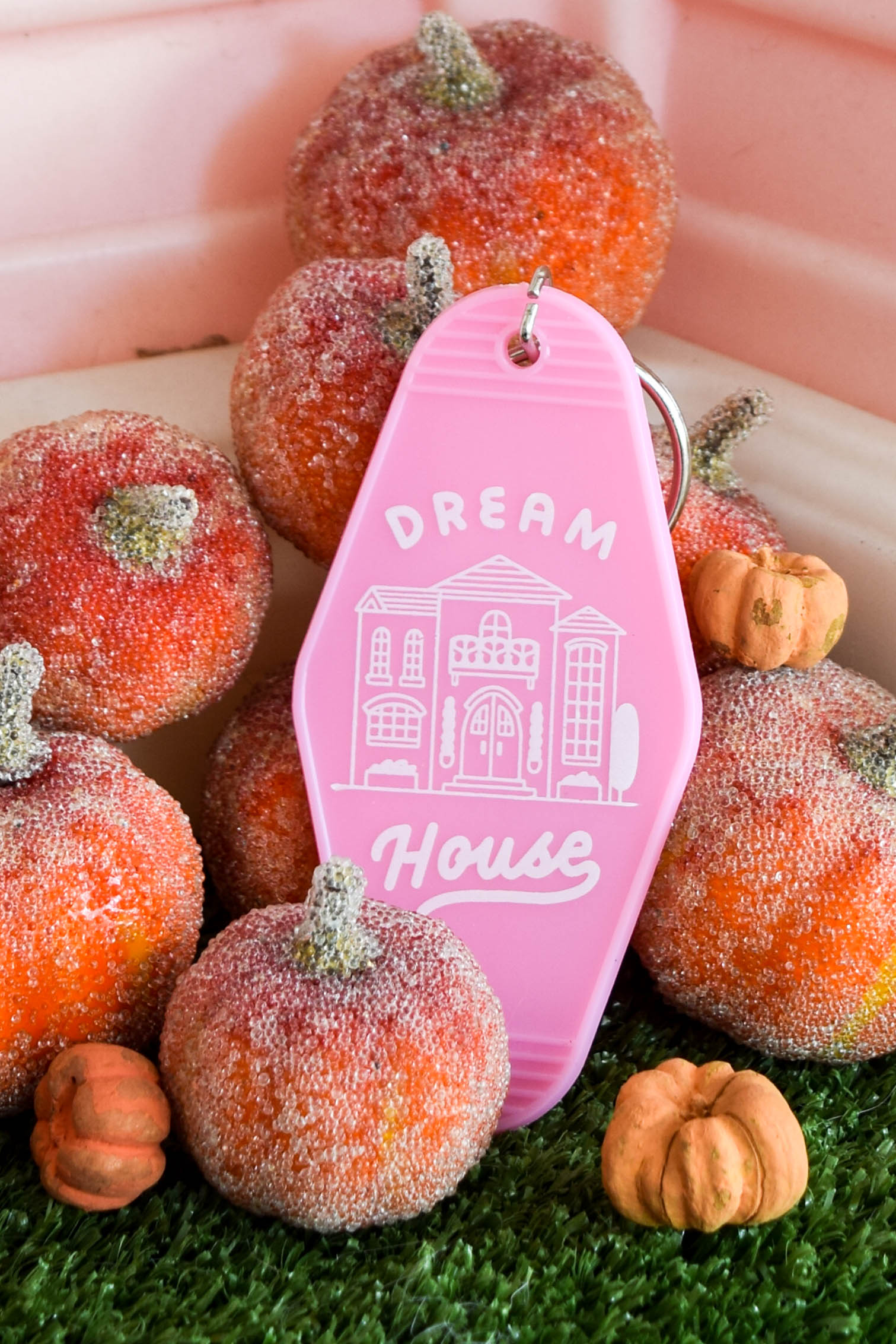 pink dream house key tag surrounded by pumpkins