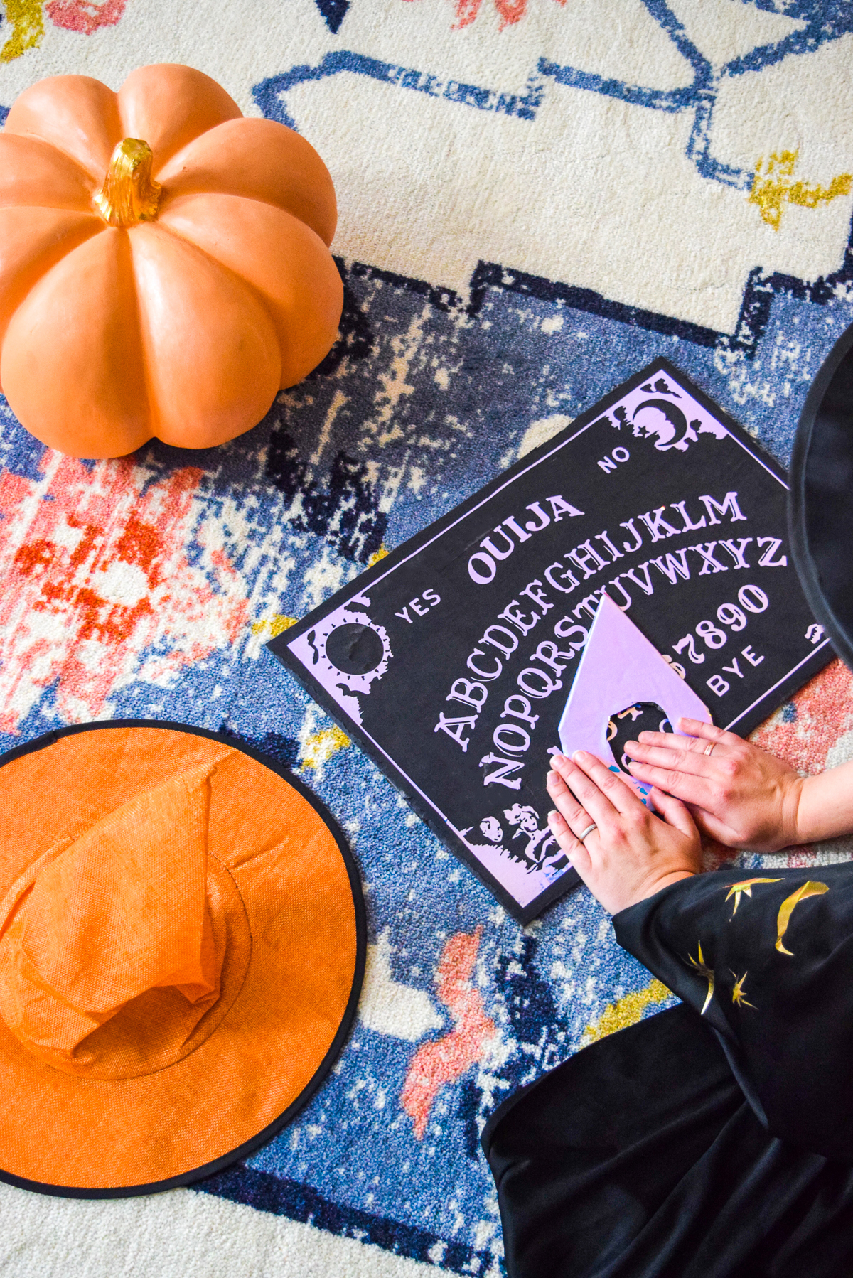 woman moving the planchette on a ouija board