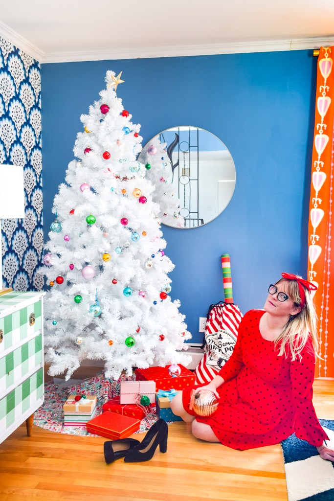 Fabulous people posing next to Christmas trees