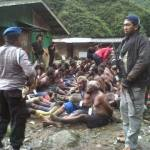 Indonesian soldiers round up West Papuan captives.