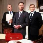 "The terminally bewildered Minister with his public service advisors in the political satire ""Yes, Minister."""
