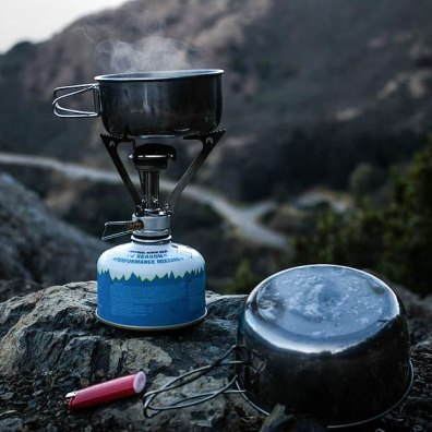 A canister style backpacking stove