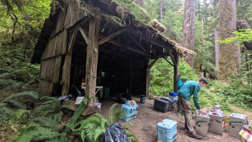 Unpacking Panniers at Hyak Shelter
